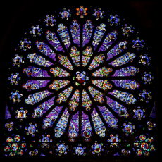 © Wikimedia Commons_The north transept rose features the Tree of Jesse._Tree of Jesse_The_north_transept_rose_window_at_St-Denis
